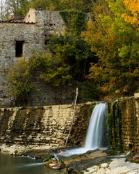 The old abandoned water mill in autumn