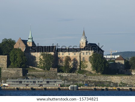 The old Akershus Castle and Fortress in oslo with a part of the Oslo Harnour in the foreground.