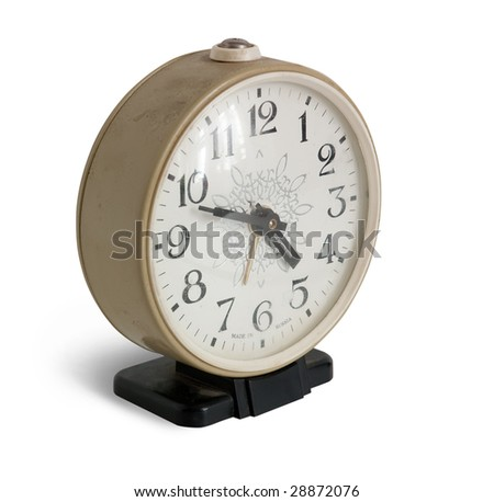 The old alarm clock. Isolated on white background