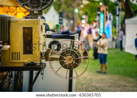 The old analog rotary film movie projector at outdoor cinema movies theater for show people in the Park.
