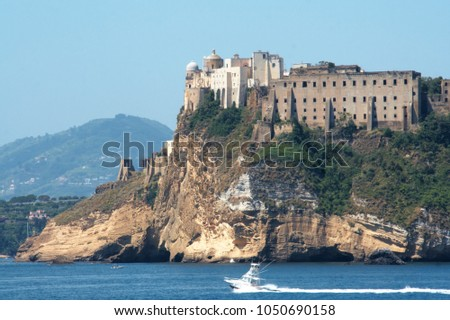 The old and abandoned prison of Procida  as seen from the sea #1050690158