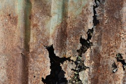 The old and dirty rusty galvanized sheet for roof and fence . corrosion of metal