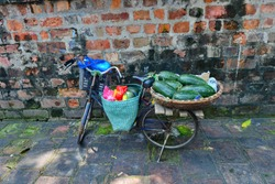 the old bicyle stand with papaya forsale at the old town Hanoi.
