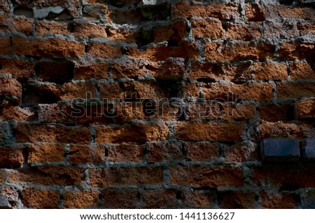 The old brick wall destroyed by the nature and time. The brick wall destroyed by an atmospheric precipitation. Brick wall in many years. #1441136627