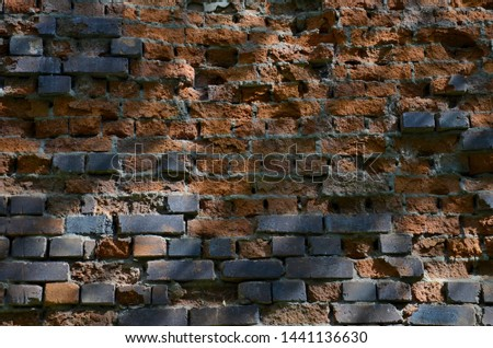 The old brick wall destroyed by the nature and time. The brick wall destroyed by an atmospheric precipitation. Brick wall in many years. #1441136630
