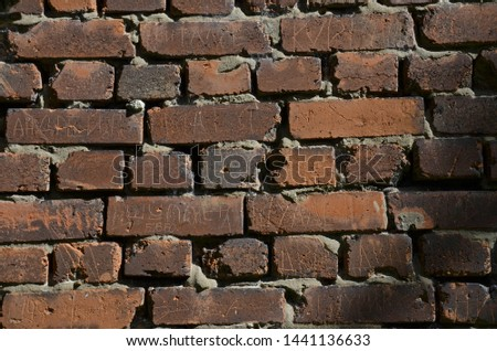 The old brick wall destroyed by the nature and time. The brick wall destroyed by an atmospheric precipitation. Brick wall in many years. #1441136633