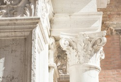 The old capital of the corinthian order on a blurred background