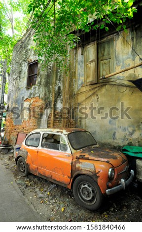 The Old car and the old house in the old area of Bangkok, Thailand.