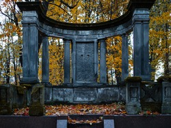 The old Catholic cemetery in the fall. Abandoned graves