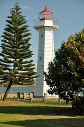 The old Cleveland Point Lighthouse is a hexagonal wooden lighthouse about 12m (38ft) tall. It is made of painted weatherboards attached to a timber frame.
