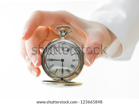 The old clock in female hands isolated