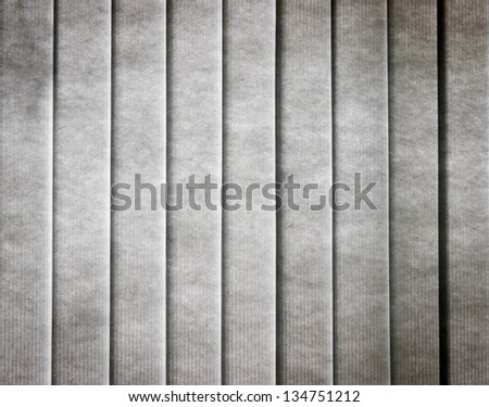 The old closed, grey, vertical curtain in grunge style