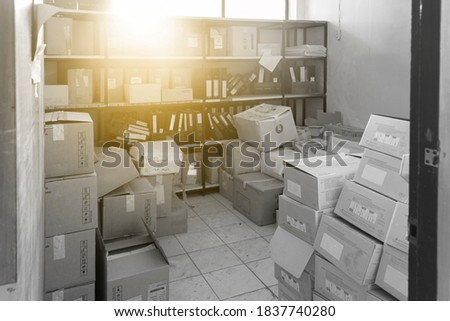 The old, cluttered archives, only sunlight shone through the box-filled room. Photo stock ©