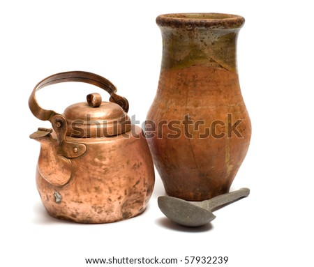 The old copper kettle, pewter spoon and ceramic  pot on a white background. - stock photo