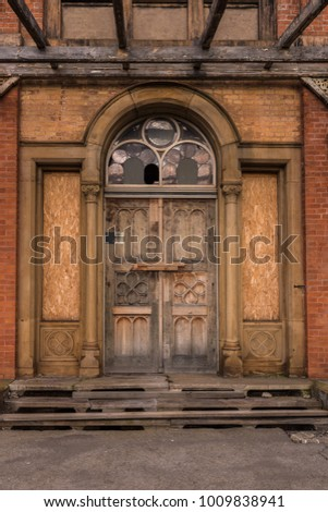 the old door of a ruined...