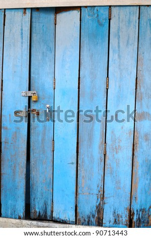 The old doors made of wood painted blue