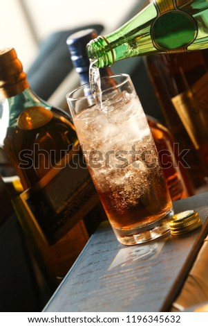 The Old Fashioned is made by whiskey and ice. It is traditionally served in a glass short, round, which is called an Old Fashioned. The Old Fashioned developed during the 19th century. #1196345632
