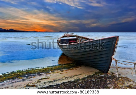 The old fishing boat at sunset