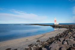 The old Gardskagaviti lighthouse on the coast of Reykjanes Peninsula in Iceland