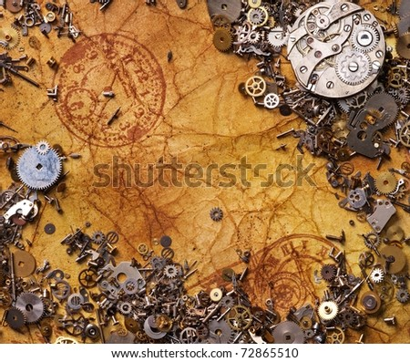 The old gears on the textured paper