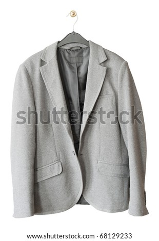The old gray jacket hangs on a hanger. Isolated on white with patch