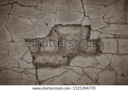 the old grey cement wall stucco texture background cracked stone bricks sepia tone #1125384770