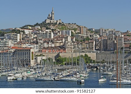 "The old harbor ""Vieux Port"" and the church ""Notre Dame de la Garde"" of ""Marseille"" in France"