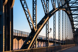 The old Harburger elbe bridge in a sunsetlight, a steel arch bridge connecting the Hamburg districts of Harburg and Wilhelmsburg via the southern Elbe.