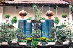 The old Houses of Hanoi's Old Quarter with blue wooden windows