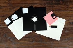 The old 8-inch floppy disk, for an old computer, a comparison with the flash drive