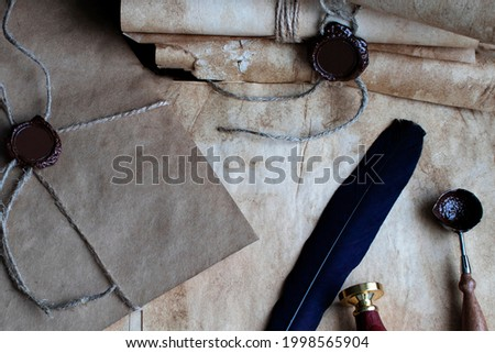 The old letter is sealed with sealing wax and a seal in an envelope. Scrolls with a wax seal.