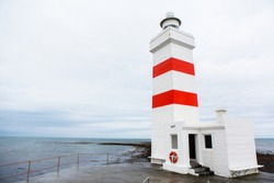 The old lighthouse in Gardur, Iceland. Beautiful landscape in Iceland. Atlantic ocean.