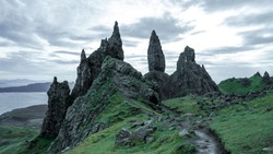 The Old Man of Storr is a daunting jagged form of rocks that over looks the lake below. This magnificent landscape is located in the Island of the Skye. The moody clouds add to its sharp texture.