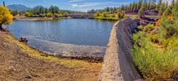 The old McLellan Reservoir Dam near Williams Arizona. The dam was built in 1937 and has fallen into disrepair.