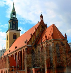 The old medieval Christian Protestant Church of St. Mary in the center of Berlin. The facade of the church building in the Gothic style.
