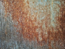 The old metal surface is rusty.  Is a grain film image