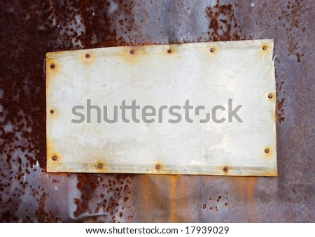 The old metal tablet on a rusty wall