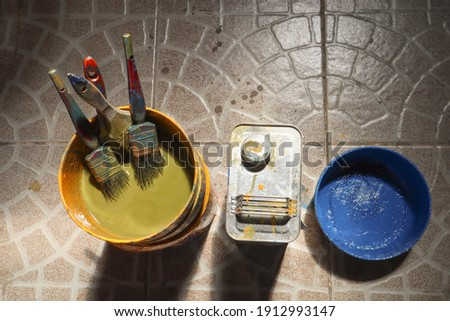 The old paint brush has been used and then soaked in a clean container with a thinner can Stock photo ©