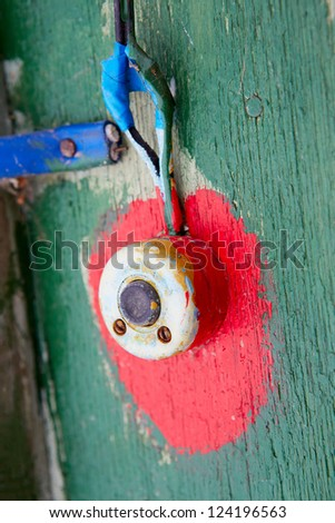 The old painted doorbell