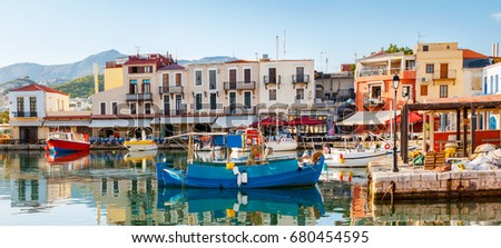 The old port is the popular tourist location, there are a lot of fishing and tourist boats for hire, cafes and taverns to relax and taste the local cuisine, Rethymno, Greece.