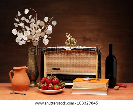 The old radio, books and strawberries on the table