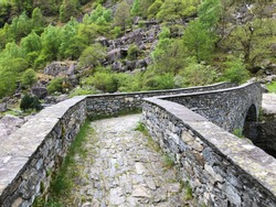 The old Roman stone bridge over the Bavona River (The Bavona Valley or Valle Bavona, Val Bavona or Das Bavonatal), Fontana - Canton of Ticino, Switzerland