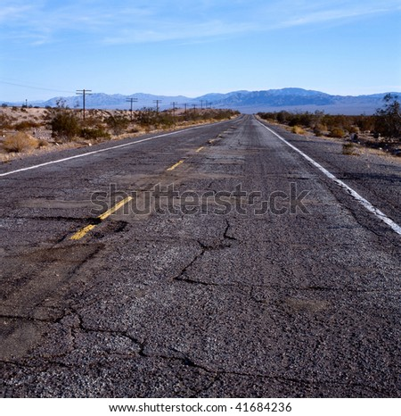 The old Route 66 with damaged pavement in the Mohave desert, California,U.S.A.