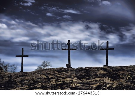 The old rugged wooden cross of the christian church.