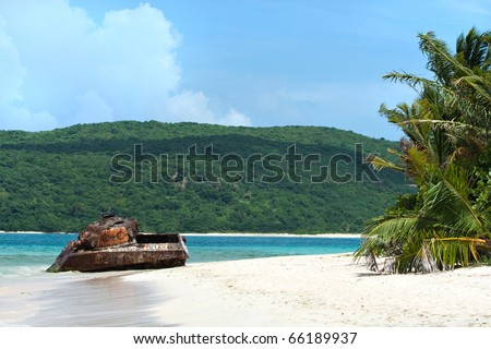 The old rusted and deserted military tank of Flamenco beach on the Puerto Rican island of Culebra. - stock photo