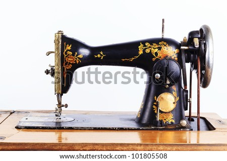 The old sewing machine on a white background - stock photo