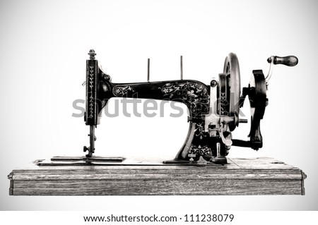 The old sewing machine on white background