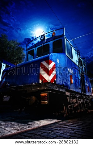 The old Soviet blue locomotive in the train yard