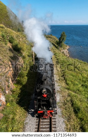 The old steam locomotive is driving along the Circum-Baikal Railway