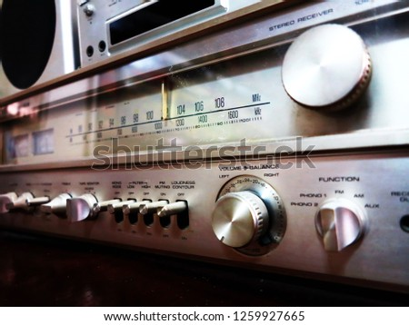 The old stereo receiver radio model which  was designed in the high classic model. This was a famous  brand named at that time.